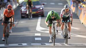 Ireland's Sam Bennett, center, and Slovakia's Peter Sagan, right, cross the finish line of the 19th stage of the Tour de France. (Benoit Tessier/Pool via AP)