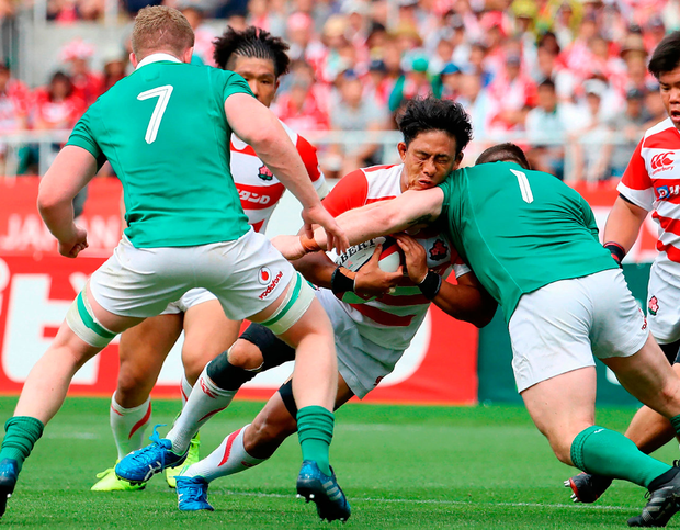 Japan's Yoshitaka Tokunaga (C) is tackled by Ireland's Cian Healy (2nd R) and Dan Leavy (L). Photo: Getty