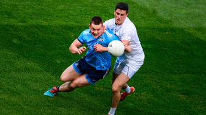 Con O'Callaghan of Dublin in action against Mick O'Grady of Kildare