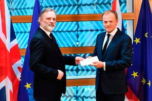 Britain's ambassador to the EU Tim Barrow delivers British Prime Minister Theresa May's formal notice of the UK's intention to leave the bloc under Article 50 of the EU's Lisbon Treaty to European Council President Donald Tusk in Brussels Photo: AFP/Getty