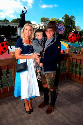 Philipp Lahm of FC Bayern Munich, his wife Claudia and son Julian pose during their visit at the Oktoberfest in Munich, Germany, September 30, 2015. REUTERS/Alexander Hassenstein/Pool
