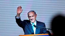 Israeli Prime Minister Benjamin Netanyahu greets supporters at the party's election headquarters In Tel Aviv. Photo: AP