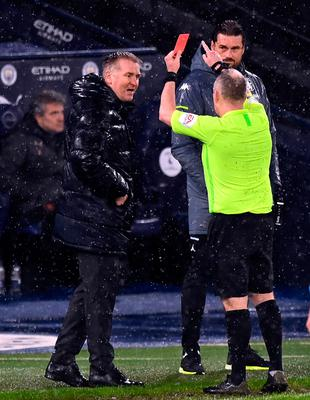 Aston Villa manager Dean Smith is shown a red card by referee Jonathan Moss during the Premier League match at the Etihad Stadium, Manchester.