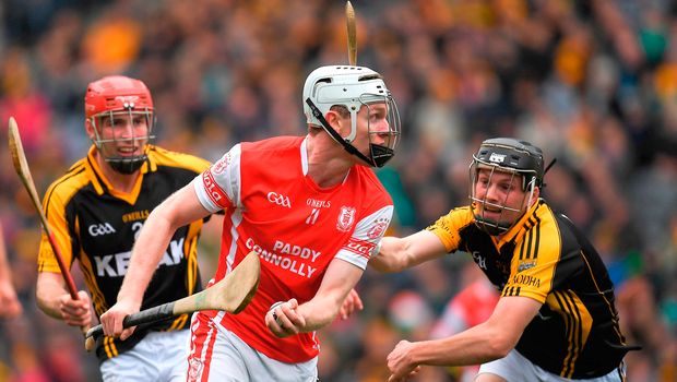 Colm Cronin of Cuala in action against Joe Neylon, left, and Jack Browne of Ballyea