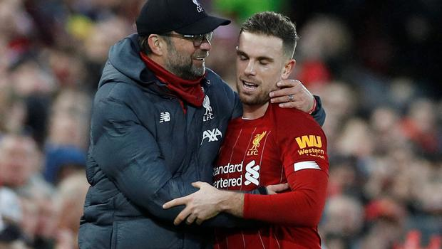 Liverpool's Jordan Henderson is embraced by manager Jurgen Klopp after being substituted in the Premier League win over Southampton at Anfield