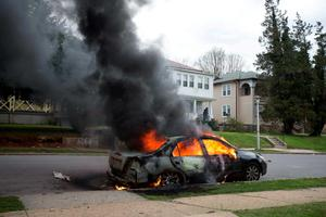 A vehicle burns during protests over the death of Freddie Gray continue, in Baltimore, Maryland. Photo: EPA