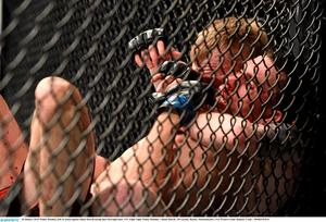 Paddy Holohan, left, in action against Shane Howell during their flyweight bout. UFC Fight Night, Paddy Holohan v Shane Howell, TD Garden, Boston