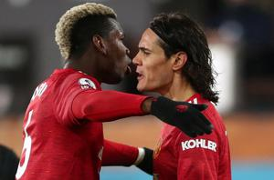 Manchester United's Edinson Cavani celebrates scoring his equaliser with Paul Pogba. Photo: Reuters