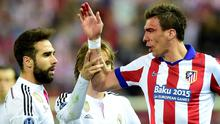 Atletico Madrid's Croatian forward Mario Mandzukic (right) argues with Real Madrid defender Dani Carvajal (left) and his team-mate Luka Modric after suffering a cut during the Champions League quarter-final clash at the Vincente Calderon Stadium in Madrid last night