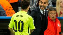 Barcelona's Lionel Messi (L) shakes hands with his former coach Pep Guardiola