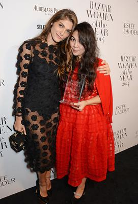 LONDON, ENGLAND - NOVEMBER 04:  Simone Rocha (R), winner of the Young Designer of the Year award, and presenter Elisa Sednaoui pose at the Harper's Bazaar Women Of The Year awards 2014 at Claridge's Hotel on November 4, 2014 in London, England.  (Photo by David M. Benett/Getty Images for Harper's Bazaar)