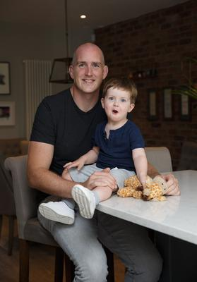 Devin Toner and son Max at the kitchen counter where he has been busy cooking and baking. MAIN PHOTO: FRAN VEALE