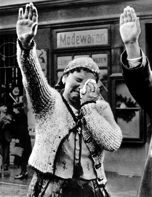 A Czech woman cannot hide her grief as she performs a Nazi salute