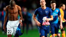 MONACO - MARCH 17:  Geoffrey Kondogbia of Monaco and Mesut Oezil of Arsenal swaps shirts at half time during the UEFA Champions League round of 16 second leg match between AS Monaco and Arsenal at Stade Louis II on March 17, 2015 in Monaco, Monaco.  (Photo by Michael Steele/Getty Images)