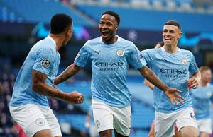 Manchester City's Raheem Sterling celebrates scoring their first goal with teammates in the Champions League Round of 16 second leg win over Real Madrid at the Etihad Stadium, Manchester