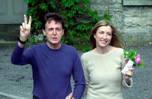 Singer Sir Paul McCartney and his fiance model Heather Mills signals to the news media at Castle Leslie June 10, 2002 in Glaslough Village, County Monaghan