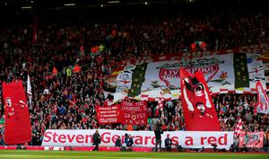 Liverpool fans with banners for Steven Gerrard before the match