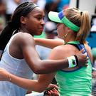 Sofia Kenin of the US gives a hug to Coco Gauff (L) of the US after their women's singles match on day seven of the Australian Open tennis tournament in Melbourne. (Photo by John DONEGAN / AFP)