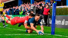 Dave Kearney dives over to score Leinster's second try despite the tackle of Toulouse's Romain Ntamack. Photo: Stephen McCarthy/Sportsfile