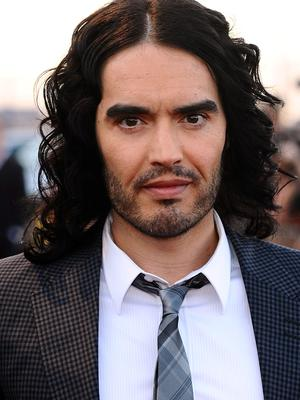 "File photo dated 19/04/11 of comedian Russell Brand who has said he is ""open-minded"" about the idea that the US government was behind the 9/11 attacks as he made a second appearance on BBC2's flagship Newsnight progamme"