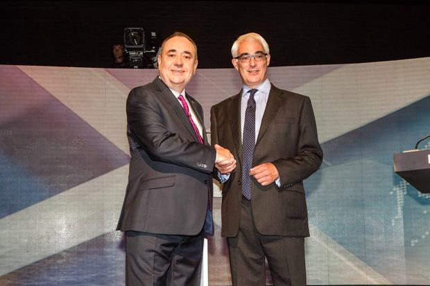 Handout photo issued by Devlin Photo Ltd of (left) Scotland's First Minister Alex Salmond and former chancellor, the leader of the pro-UK Better Together campaign Alistair Darling at a TV debate of the independence referendum campaign in Glasgow.