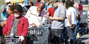 Stocking up: Shoppers queue to stock up on groceries during a nationwide lockdown of 21 days to try to contain the coronavirus outbreak in Johannesburg in South Africa. Photo: Siphiwe Sibeko/Reuters