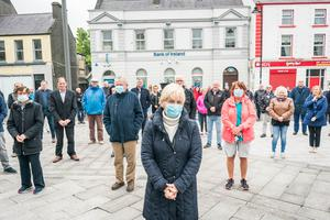 Anger: Residents and business owners of Ballyhaunis outside the Bank of Ireland branch. PHOTO : KEITH HENEGHAN