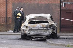 A burnt-out car found on Etna Drive in Belfast following the murder of Dublin hitman Robbie Lawlor