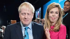 Prime Minister Boris Johnson with partner Carrie Symonds (Stefan Rousseau/PA)