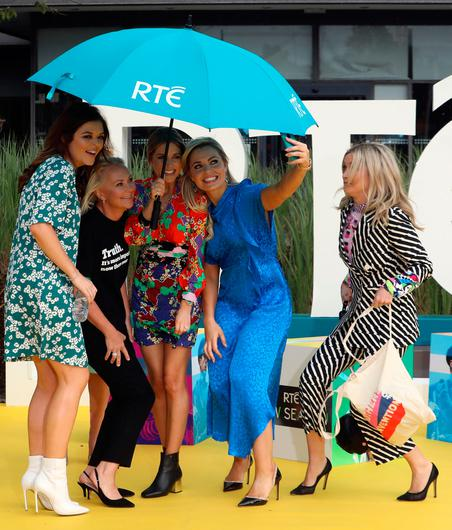 16/8/2018 RTE announce New Season Launch - Laura Whitmore (Right of pic) rushes to join other RTE stars under an umbrella as they pose for a selfie after rain interrupted a photocall at Donnybrook in Dublin yesterday(Thurs) - L-R: Doireann Garrihy, Dr Eva Orsmond, Amy Huberman, and Anna Geary.Pic: Collins