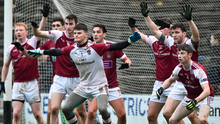 Members of the NUIG team along the goal line as Mayo take a free during the closing stages. Photo: David Maher/Sportsfile