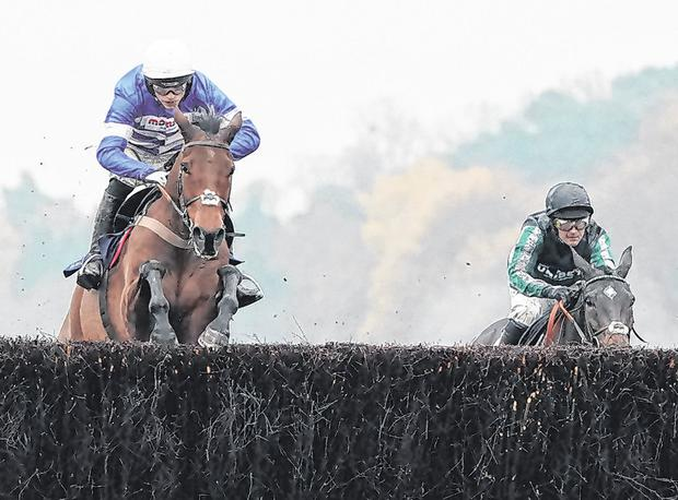 Harry Cobden steers Cyrname over the last to win The Christy 1965 Chase from Altior and Nico de Boinville at Ascot last month. Photo: Alan Crowhurst/Getty Images