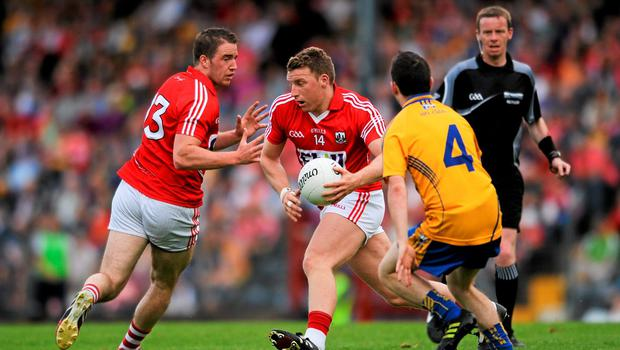 Brian Hurley, Cork, in action against Martin McMahon, Clare