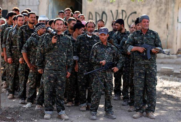 Iraqi volunteers from the Yazidi sect gather during a training camp at the Serimli military base. Photo: REUTERS/Youssef Boudlal
