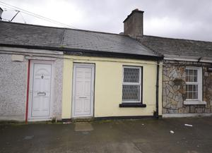 The exterior of the period cottage located at 32 Maxwell Street