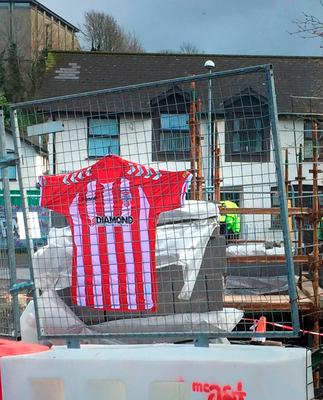 A football shirt hangs at the Derry City football ground at the Brandywell in memory of Ryan McBride Photo: Michael McHugh/PA Wire