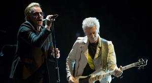 Bono, left, and Adam Clayton, of the band U2, perform in the band's first concert of their new world tour in Vancouver. Photo: Jonathan Hayward/The Canadian Press via AP