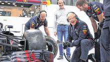 Campaign drive: Boris Johnson changes a wheel on a Formula One car during his visit to Red Bull Racing in Milton Keynes, England. Photo: Reuters