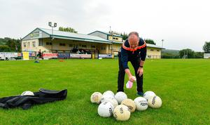Paul Gallagher, team offical, sanitizing the balls before a Glenswilly GAA Club training session at Glenkerragh in Donegal