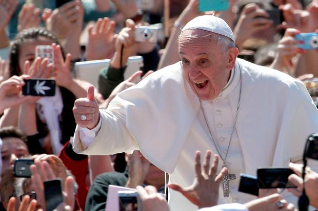 Hats off: Kirsty is hoping Pope Francis will throw sartorial caution to the wind and follow his predecessor, Pope Benedict's style when he arrives on these shores next year