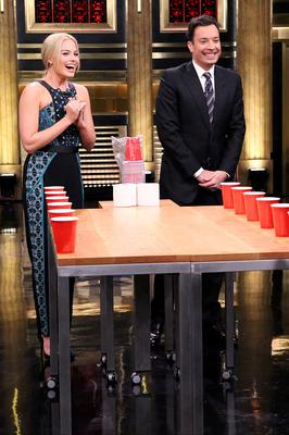 Actress Margot Robbie plays Beer Pong with host Jimmy Fallon on February 26, 2015 -- (Photo by: Douglas Gorenstein/NBC/NBCU Photo Bank via Getty Images)