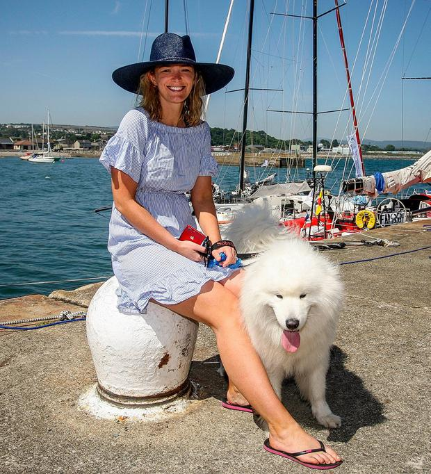 Susie McAdam and Mischko, from Limerick, bask in the hot sun as they wait for the start of the Volvo Round Ireland Yacht Race at Wicklow harbour. Photo: Garry O'Neill