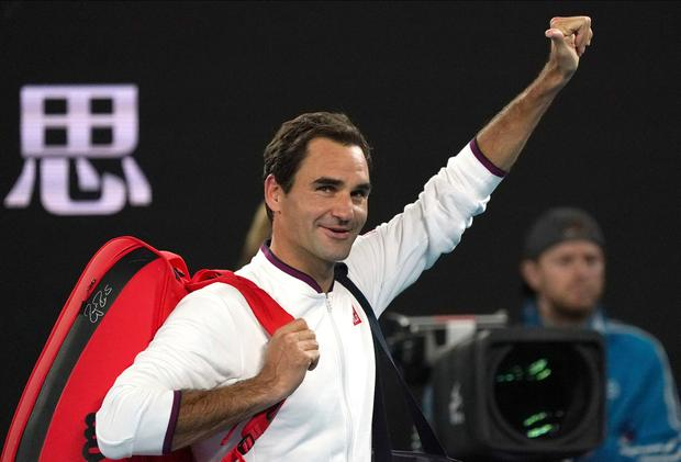 Switzerland's Roger Federer gestures to the crowd as he leaves Rod Laver Arena at the 2020 Australian Open. (AP Photo/Lee Jin-man)