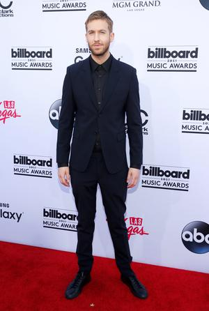 Calvin Harris arrives at the Billboard Music Awards at the MGM Grand Garden Arena on Sunday, May 17, 2015, in Las Vegas. (Photo by Eric Jamison/Invision/AP)