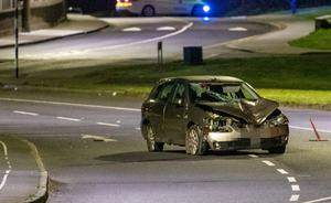 The suspects abandoned the car after it crashed, killing one woman and injuring another