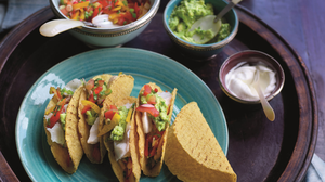 Fish tacos with guacamole and pepper and spring onion salsa