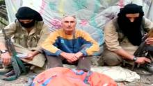 Herve Gourdel sits in between two masked gunmen in this file still image taken from video which was published on the Internet on September 22. Algerian militants who kidnapped the Frenchman claimed to have killed him after demanding France stop its action against militants in Iraq. Reuters