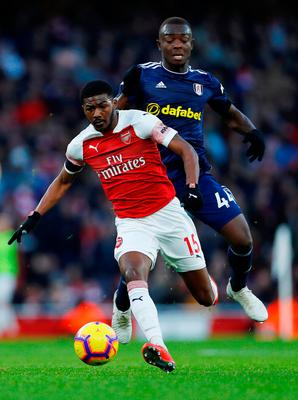 Arsenal's Ainsley Maitland-Niles in action with Fulham's Ibrahima Cisse. Photo: Eddie Keogh/Reuters