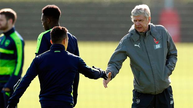 Alexis Sanchez and Arsene Wenger shake hands prior to training in London ahead of tonight's game against Bayern Munich Photo: Reuters / John Sibley