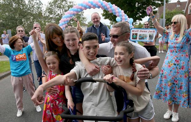 Jack O'Donovan, who completed an extraordinary 5km fundraiser, celebrates with family and friends in Swords, Co Dublin. Photo: Mark Stedman